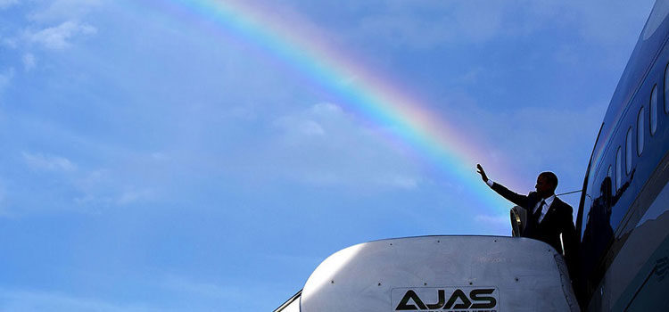 The President's wave aligns with a rainbow as he boards Air Force One [Pete Souza]